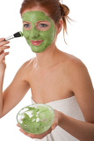 Body care series - Attractive woman applying green facial mask