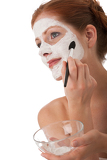 Body care series - Portrait of beautiful woman applying white facial mask