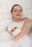 Body care series - Young woman having bath
