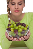 Healthy lifestyle series - Woman with grapes