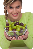 Healthy lifestyle series - Woman holding bowl of grapes