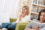 Students - Two female teenager studying in modern living room