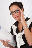 Fotografia Female architect holding plans and glasses