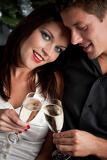 Fotografie Portrait of extravagant man and woman with champagne