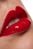 Close-up of gloosy red woman lips