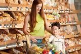 Grocery store shopping - Red hair woman with little boy