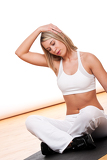 Fitness series - Blond woman stretching