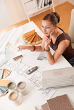 Interior designer young woman with color samples