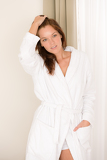 Morning bedroom - woman in bathrobe