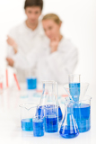 Scientists in laboratory - blue liquid