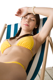 Beach - Beautiful woman sunbathing in bikini on deckchair