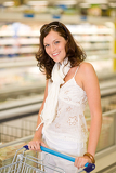 Grocery store - smiling woman shopping