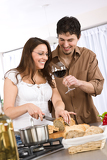 Cooking - happy couple together in modern kitchen
