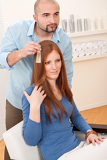 Fotografie Professional hairdresser choose hair dye color at salon