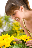 Fotografie Gardening - portrait of woman with sunflower
