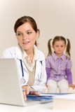 Fotografie Female doctor write prescription for child