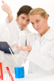 Scientists in laboratory with chemicals