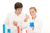 Scientists in laboratory test chemicals