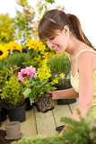 Gardening - smiling woman holding flower pot