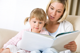 Mother with surprised little girl read book together