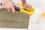 Fotografie Home improvement, renovation - handyman laying tile