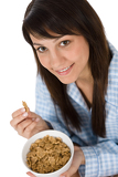 Smiling woman eat healthy cereal for breakfast