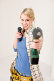 Photo Home improvement - woman with battery screwdriver