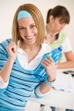 Student at home - smiling woman with bottle of water
