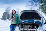 Fotografie Winter car breakdown - woman call for help