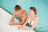 Swimming pool - young cheerful couple have fun