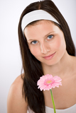 Beautiful woman holding gerbera daisy flower