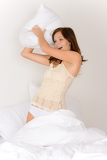 PIllow fight - young woman in bed