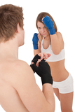 Boxing - Young woman in class training on white