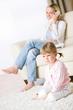 Photo Mother and child in living room watch television