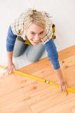 Home improvement - handywoman installing wooden floor