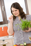 Cook - plus size woman with herb and vegetable