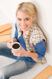 Fotografie Home improvement - handywoman coffee break
