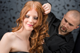 Fotografia Professional hairdresser with fashion model at luxury salon