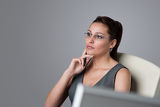 Thoughtful businesswoman thinking at office