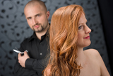 Fotografie Professional hairdresser with fashion model at luxury salon