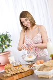 Baking - Happy woman prepare healthy ingredients
