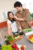 Happy couple cook together in modern kitchen