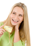 Home shopping - young woman holding credit card