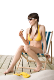 Fényképek Beautiful woman in bikini with ice cream cone in summer