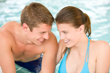 Fotografie Swimming pool - young loving couple have fun