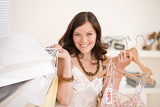 Photo Fashion shopping - Happy woman choose sale clothes