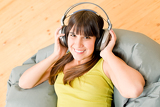 Photo Teenager girl relax home - happy listen to music