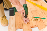 Photo Home improvement - handyman installing wooden floor