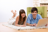 Student - two teenager with laptop in living room