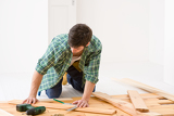 Fotografie Home improvement - handyman installing wooden floor